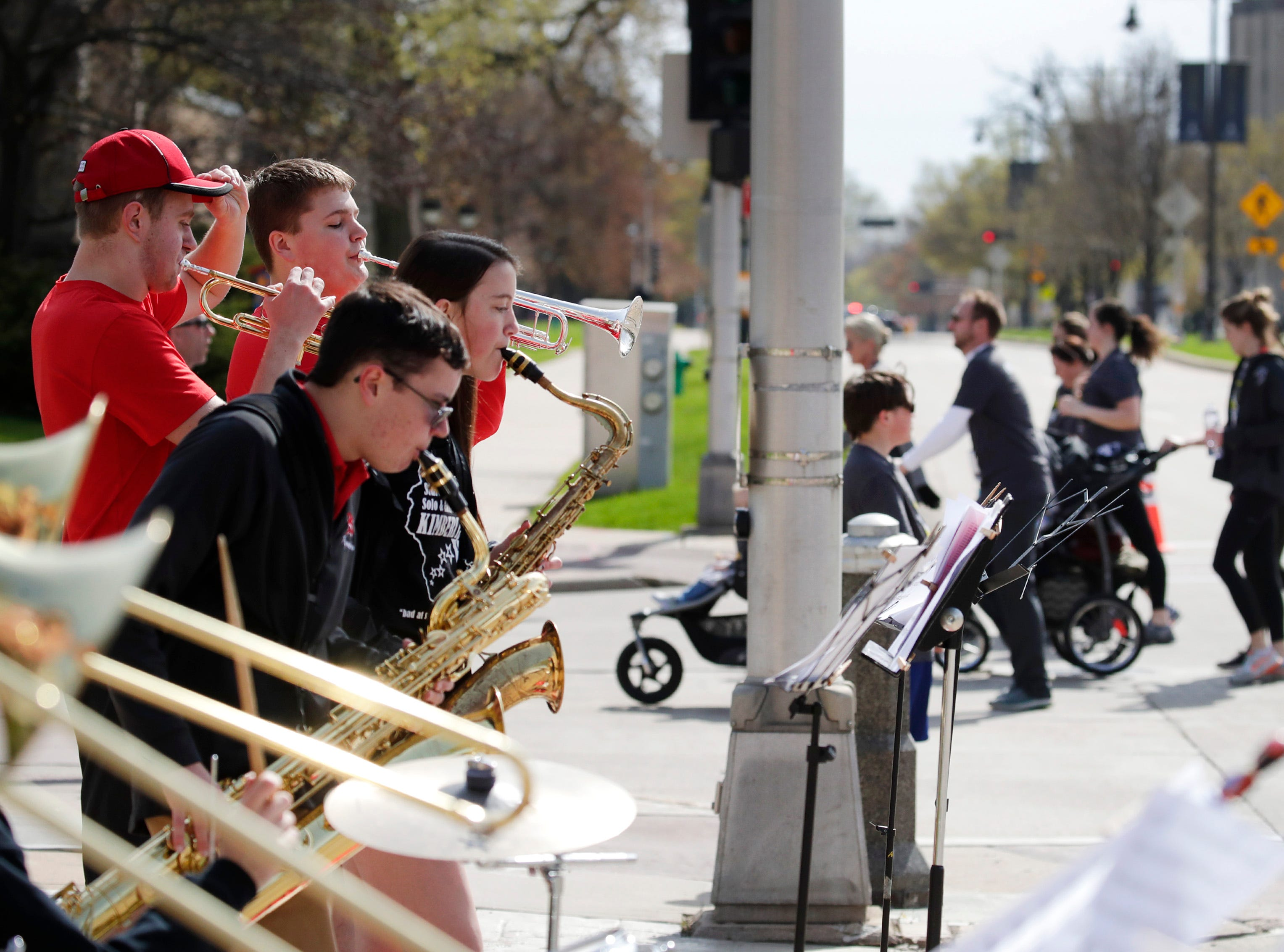 Members of the Kimberly band play for runners and walkers as they near the finish line during the Sole Burner 5K Walk-Run Saturday, May 11, 2019, in Appleton, Wis. Danny Damiani/USA TODAY NETWORK-Wisconsin