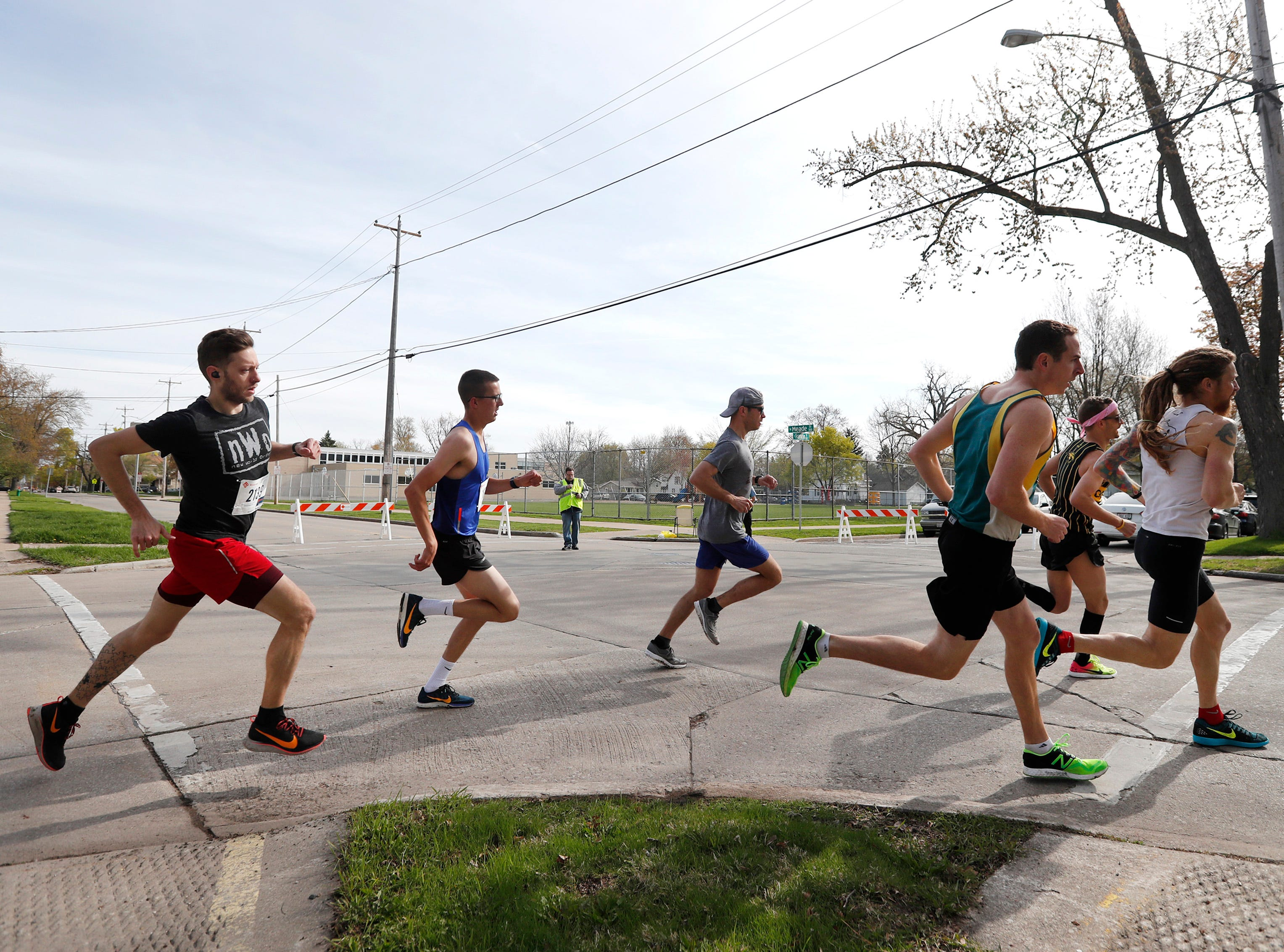 A group of runners make their first turn onto Meade Street during the Sole Burner 5K Walk-Run Saturday, May 11, 2019, in Appleton, Wis. Danny Damiani/USA TODAY NETWORK-Wisconsin