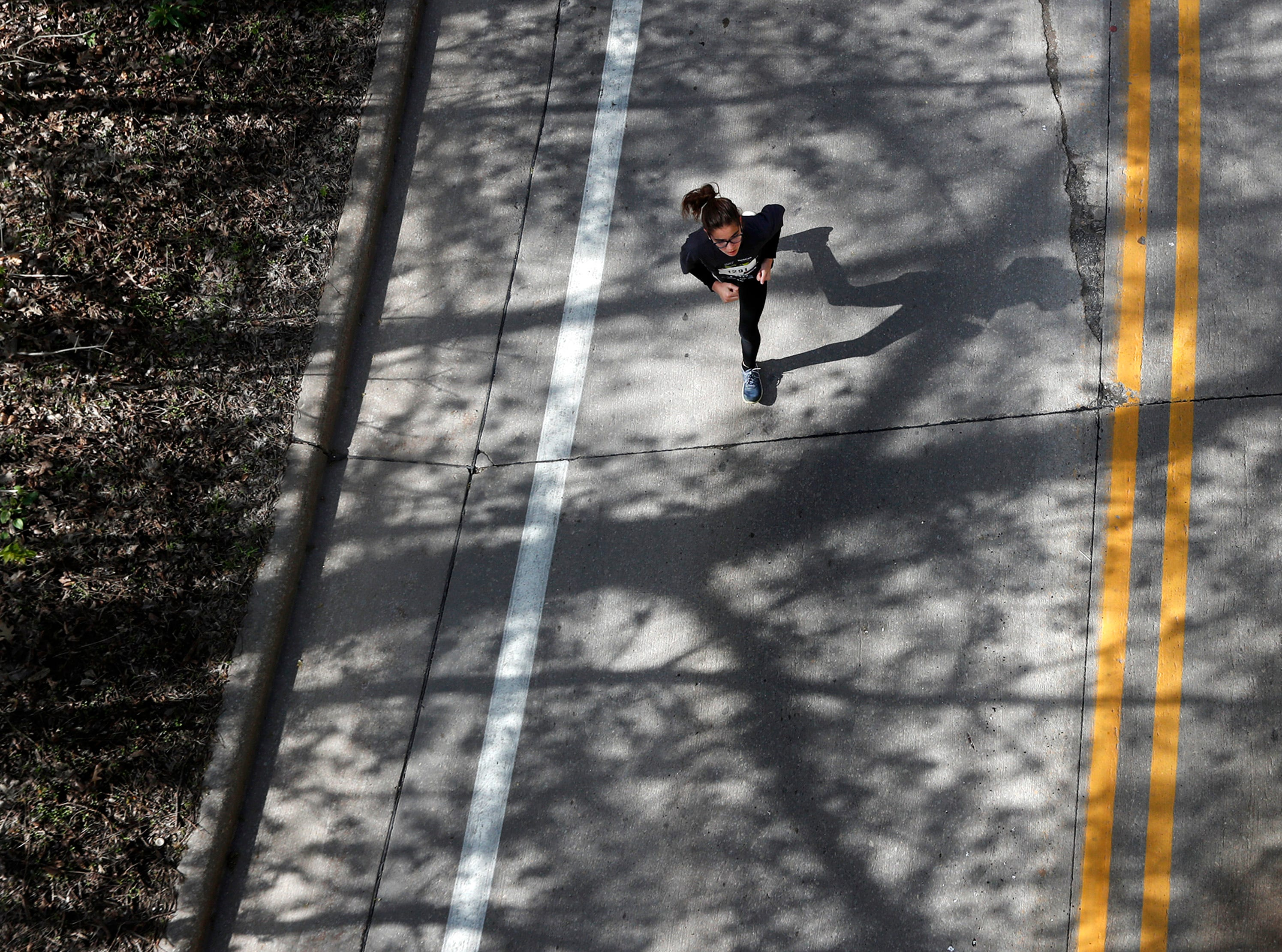 """Roxane Keuler makes her way up """"The Hill of Hope, on the way to the finish line of the Sole Burner 5K Walk-Run Saturday, May 11, 2019, in Appleton, Wis. Danny Damiani/USA TODAY NETWORK-Wisconsin"""