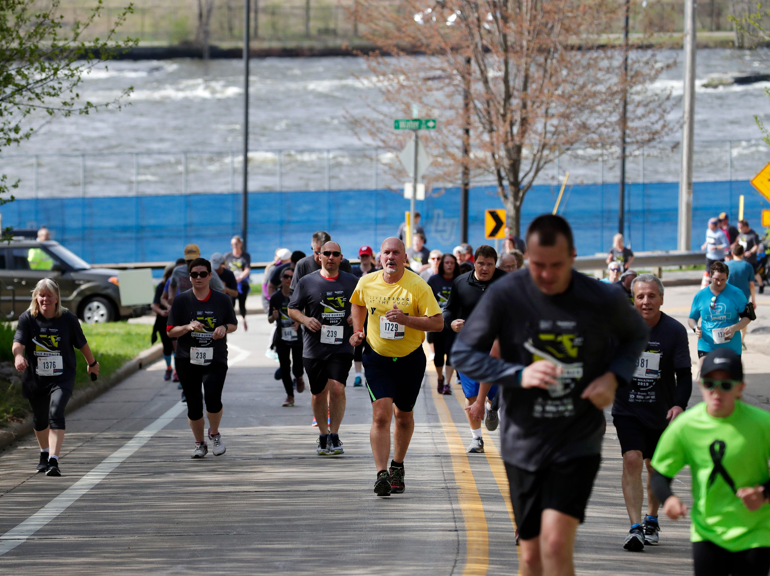 """Participants in the Sole Burner 5K Walk-Run make their way up Drew Street, or """"The Hill of Hope,"""" near the finish of the race Saturday, May 11, 2019, in Appleton, Wis. Danny Damiani/USA TODAY NETWORK-Wisconsin"""