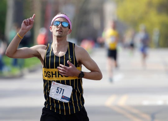 Erik Hofferber of Neenah takes first place in the Sole Burner 5K Walk-Run on May 11, 2019.