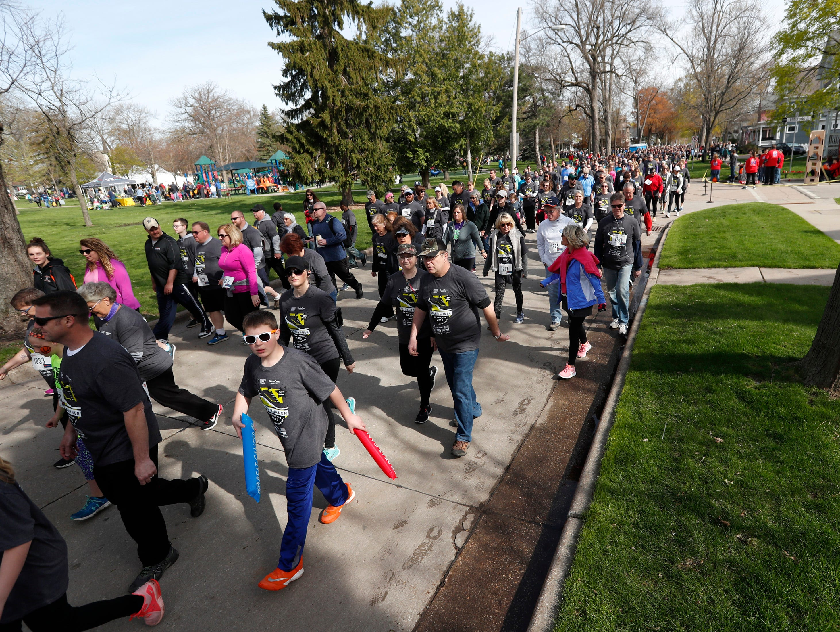 Walkers take to the street during the Sole Burner 5K Walk-Run Saturday, May 11, 2019, in Appleton, Wis. Danny Damiani/USA TODAY NETWORK-Wisconsin