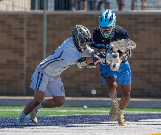 Quinn Burns, Manasquan and Terrence Lacewell, CBA, battle for loose ball during second half action. Manasquan Boys  defeat Christian Brothers Academy in Shore Conference Boys  Lacrosse final in West Long Branch, NJ on May 11, 2019.