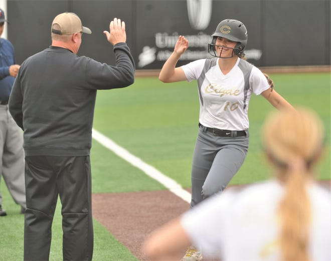 Clyde's Kaitlyn Turner, right, gets ready to high-five coach Reagan Sewell after rounding third base following her three-run home run in the fifth inning against Eastland. Clyde beat the Lady Mavs 5-2 on Saturday, May 11, 2019, to sweep the best-of-three Region I-3A quarterfinal playoff series at ACU's Poly Wells Field.