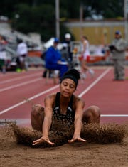 Refugio's Tracelyn Ross lands in the pit sand during the Class 2A Girls Long Jump