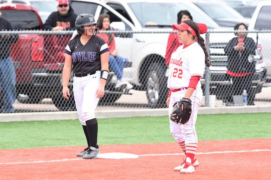 Wylie's Molly Mason (15) stands at third base after a three-run triple in the top of the seventh of Game 2 against Lubbock Coronado in Hermleigh. The Lady Bulldogs won 8-4 and 10-7 on Saturday to win the series.