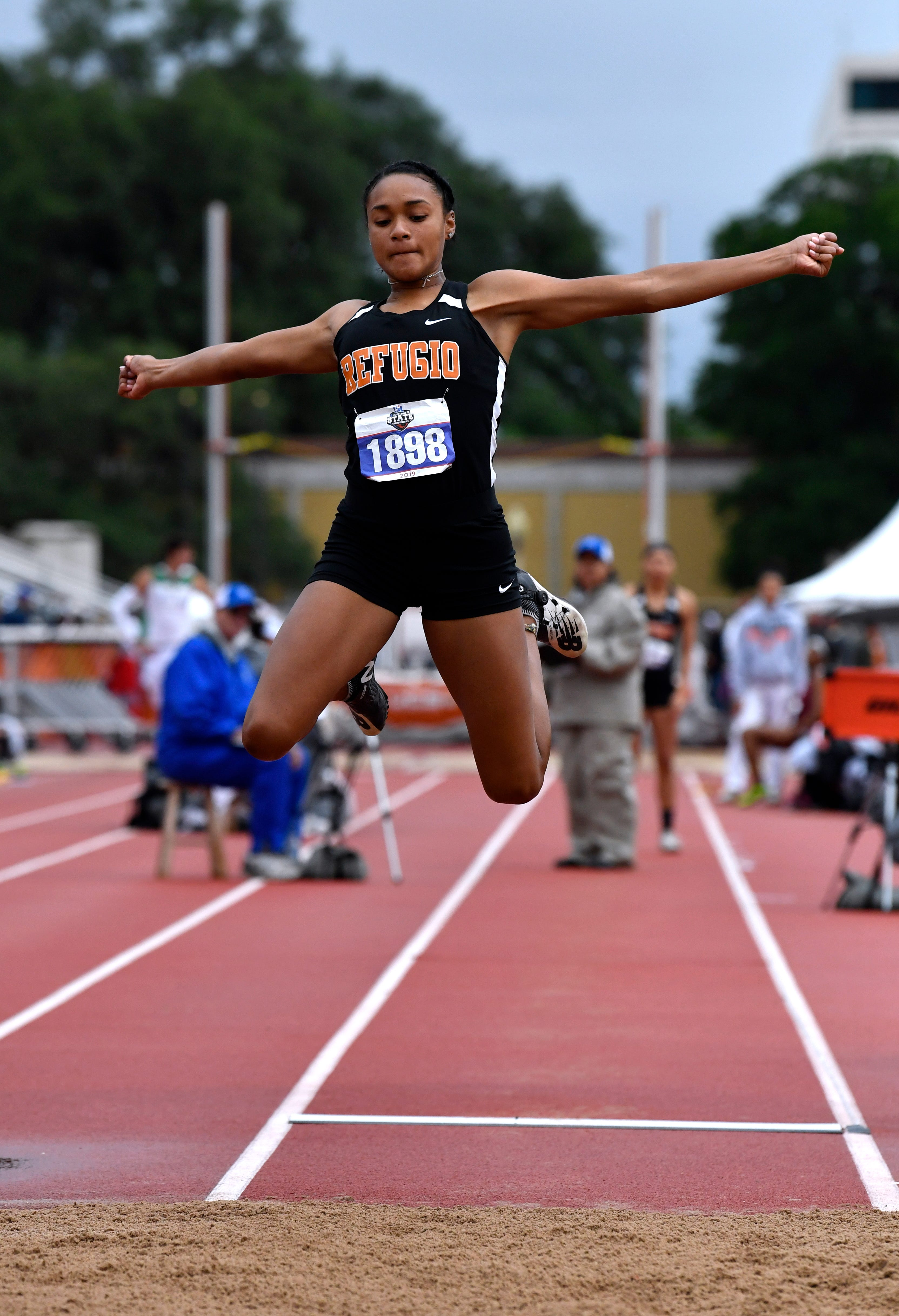Refugio's Alexa Valenzuela flies through the air during the Class 2A Girls Long Jump at the UIL State Track & Field Championships in Austin Saturday May 11, 2019.