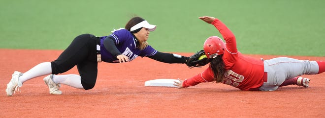 Wylie shortstop Halle Arbilera (8) reaches to tag out Lubbock Coronado's Thalia Perez (20) during Game 1 of the Region I-5A quarterfinal series in Hermleigh on Friday, May 10, 2019. The Lady Bulldogs fell 7-2.