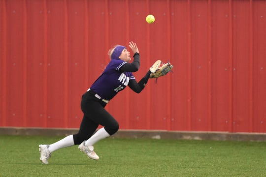 Wylie outfielder Lilly New (16) readjusts to catch a fly ball during Game 1 of the Region I-5A quarterfinal series against Lubbock Coronado in Hermleigh on Friday, May 10, 2019. The Lady Bulldogs fell 7-2.