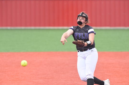 Wylie pitcher Bailey Buck (4) works during Game 3 of the Region I-5A quarterfinal series against Lubbock Coronado on Saturday in Hermleigh. Buck and the Lady Bulldogs won 10-7 to take the series.