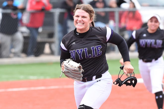Wylie pitcher Kaylee Philipp (3) runs off the field after ending Game 2 with a strikeout. The Lady Bulldogs won 8-4 and finished off the series with a 10-7 win in Game 3 against Lubbock Coronado at Hermleigh.