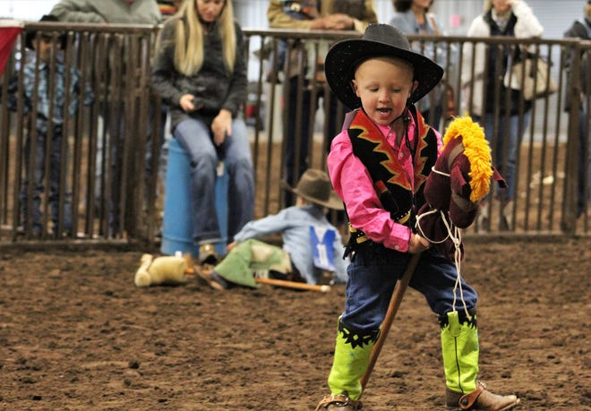 Maverick Mason rides a tough bronc during the Stickhorse Rodeo for the littlest cowboys and cowgirls Saturday morning at the Western Heritage Classic.