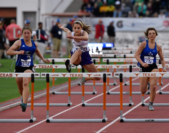 Early's Trinity Tomlinson leaps ahead of Keene's Grace Stephens (left) and Van Alstyne's Sydney Ingram as she wins the Class 3A Girls 100 Meter Hurdles at the UIL State Track & Field Championships in Austin Friday May 10, 2019.