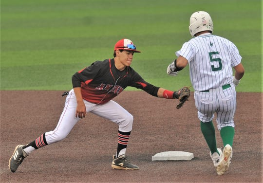 Anson shortstop Dylan Pyle, left, tags out Breckenridge's Tristan Garcia, who was trying to steal second in the fifth inning. The Buckaroos beat the Tigers 12-2 in six innings in the opener of the best-of-three Region I-3A second-round series Friday, May 10, 2019, at ACU's Crutcher Scott Field. Breckenridge finished off the series with a 13-1 win in Game 2 later that night.
