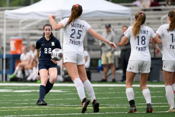 Roberson's Hope Ingram slams a free kick over the Mount Tabor defense to score a goal during their NCHSAA 3A playoff game at Roberson High School on May 10, 2019. Roberson defeated Mount Tabor 3-0 to advance.