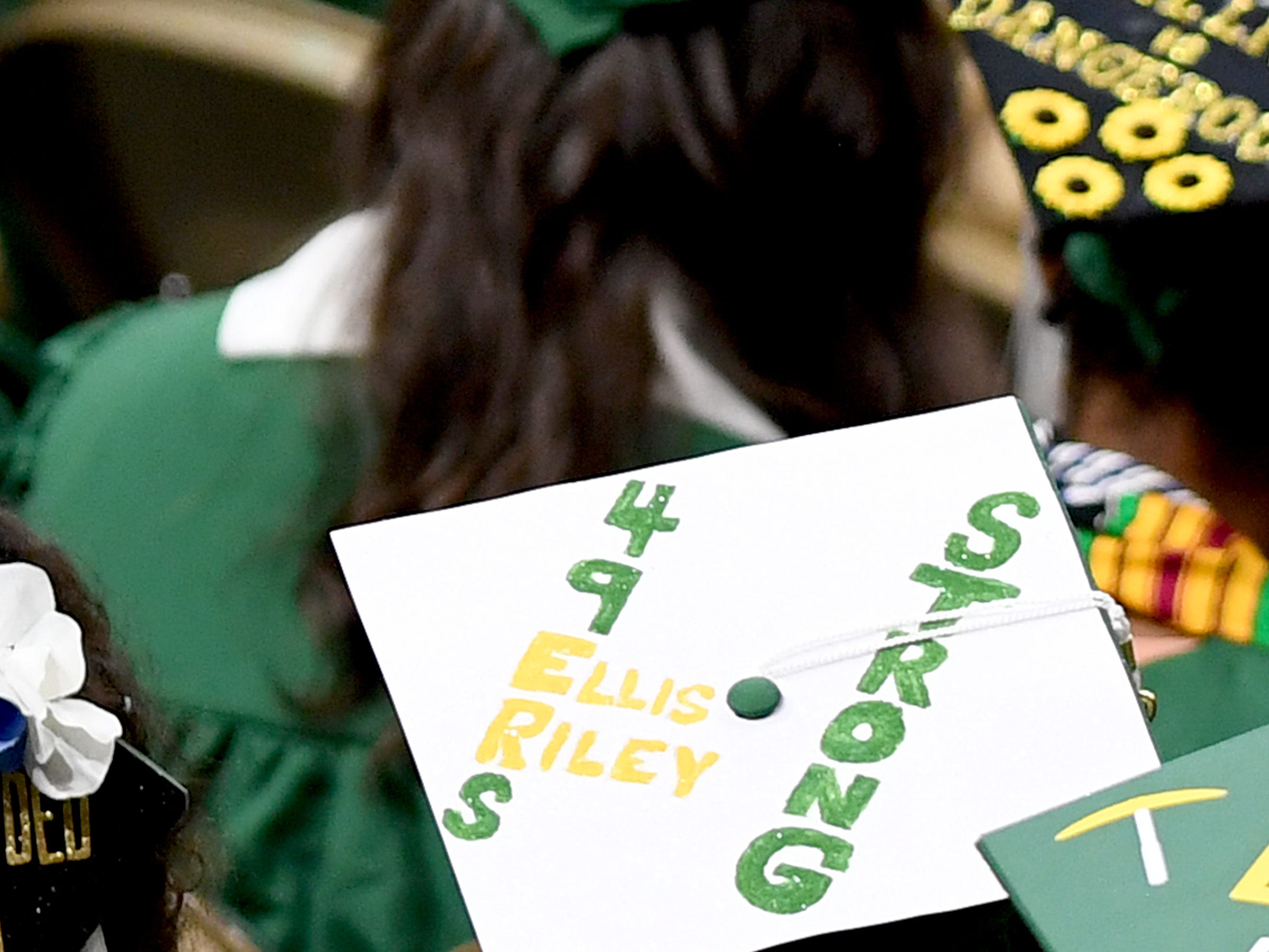 A UNC Charlotte graduate wears a decorated cap honoring the two victims of the April 30 shooting at the university, Riley Howell and Ellis Parlier during the University's Commencement ceremony for the College of Liberal Arts and Sciences in Charlotte on May 11, 2019.