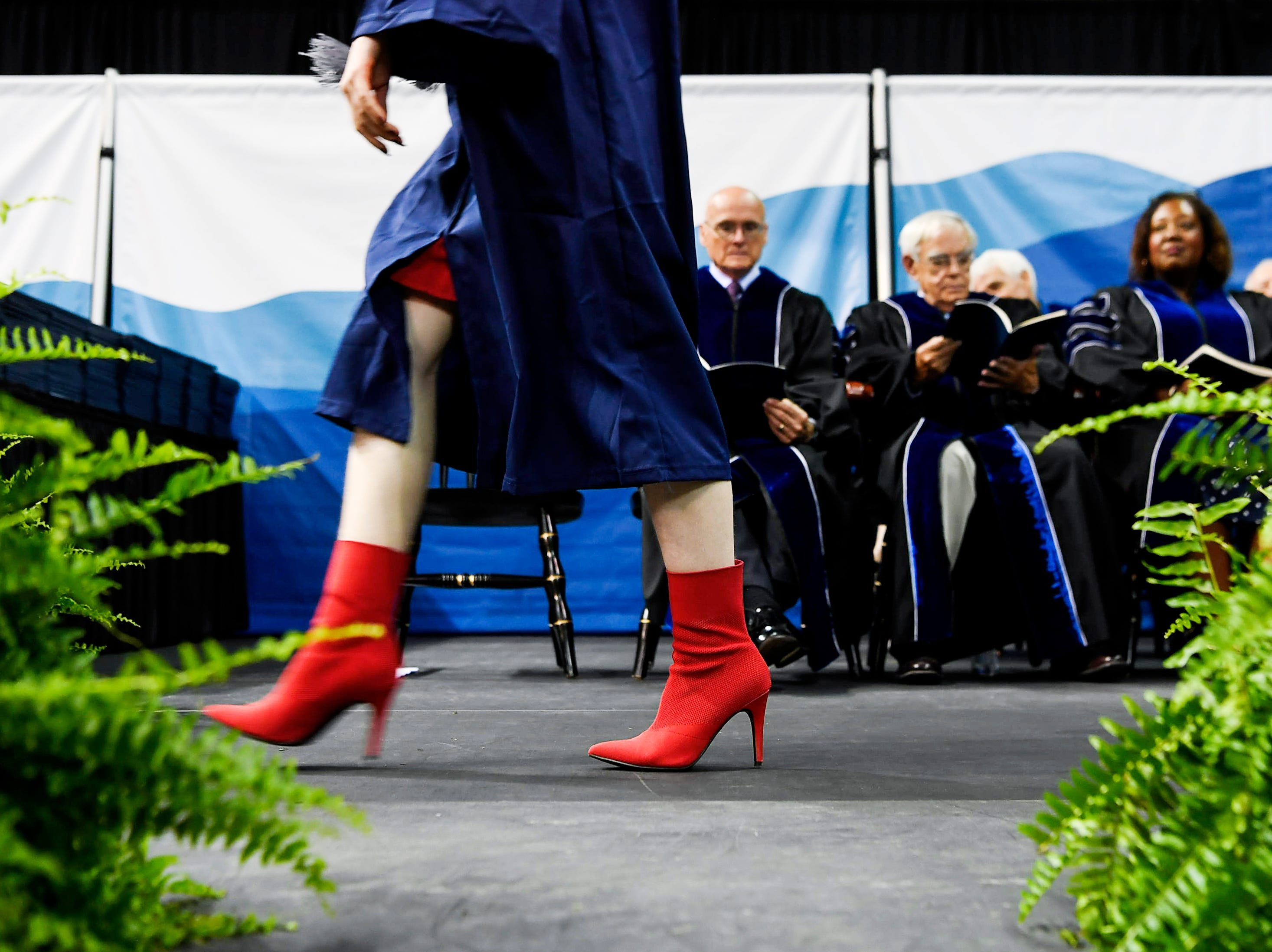 Taylor Beyrer walks across the stage to receive her psychology degree Magna Cum Laude at Kimmel Arena May 11, 2019.