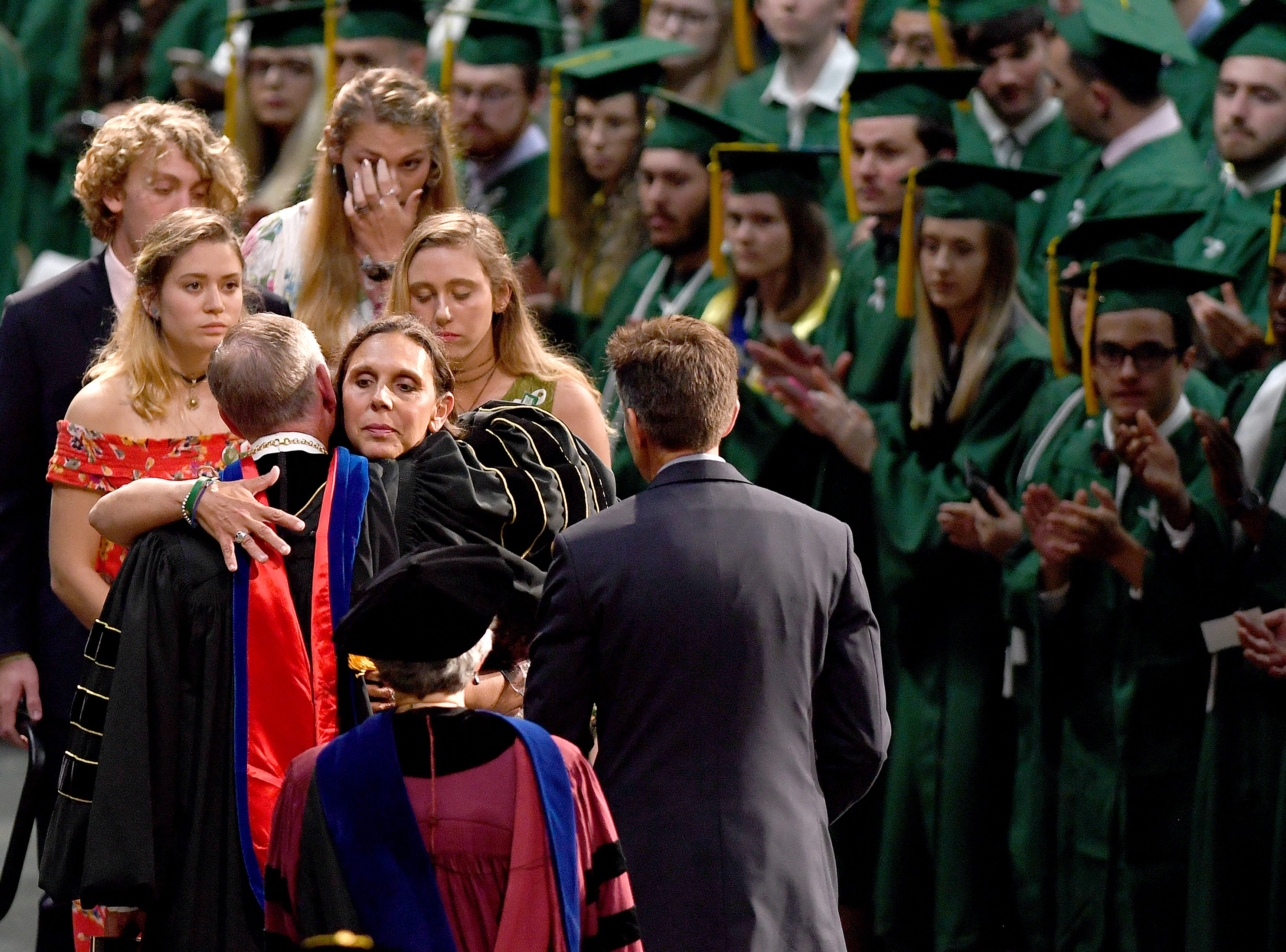 Riley Howell's mother, Natalie Henry-Howell hugs UNC Charlotte Chancellor Philip Dubois as she and her family are honored and her son is awarded with a B.A. in Memoriam during the University's Commencement ceremony for the College of Liberal Arts and Sciences in Charlotte on May 11, 2019. Riley Howell was killed in the April 30 shooting at the university.