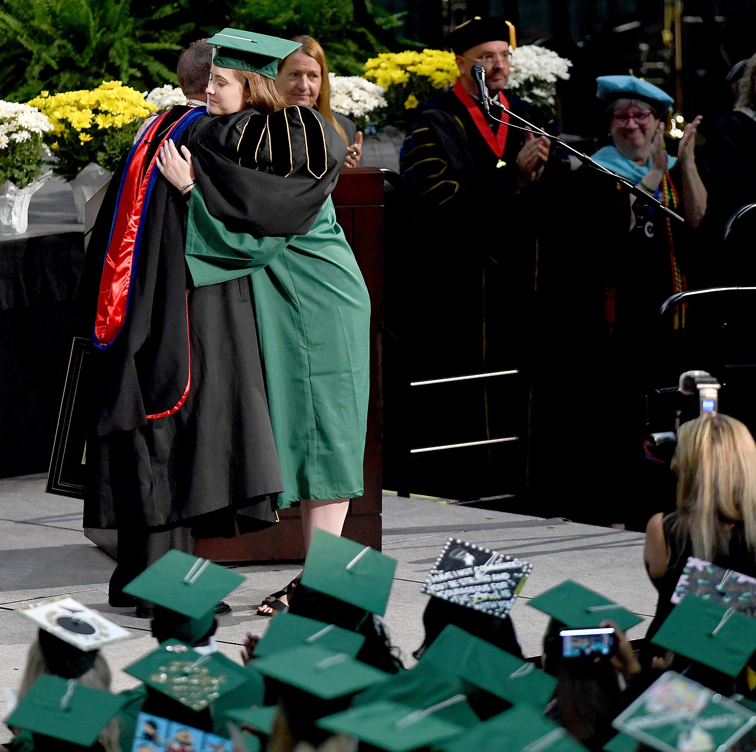 UNCC victim receives degree 11 days after shooting, slain students honored at commencement
