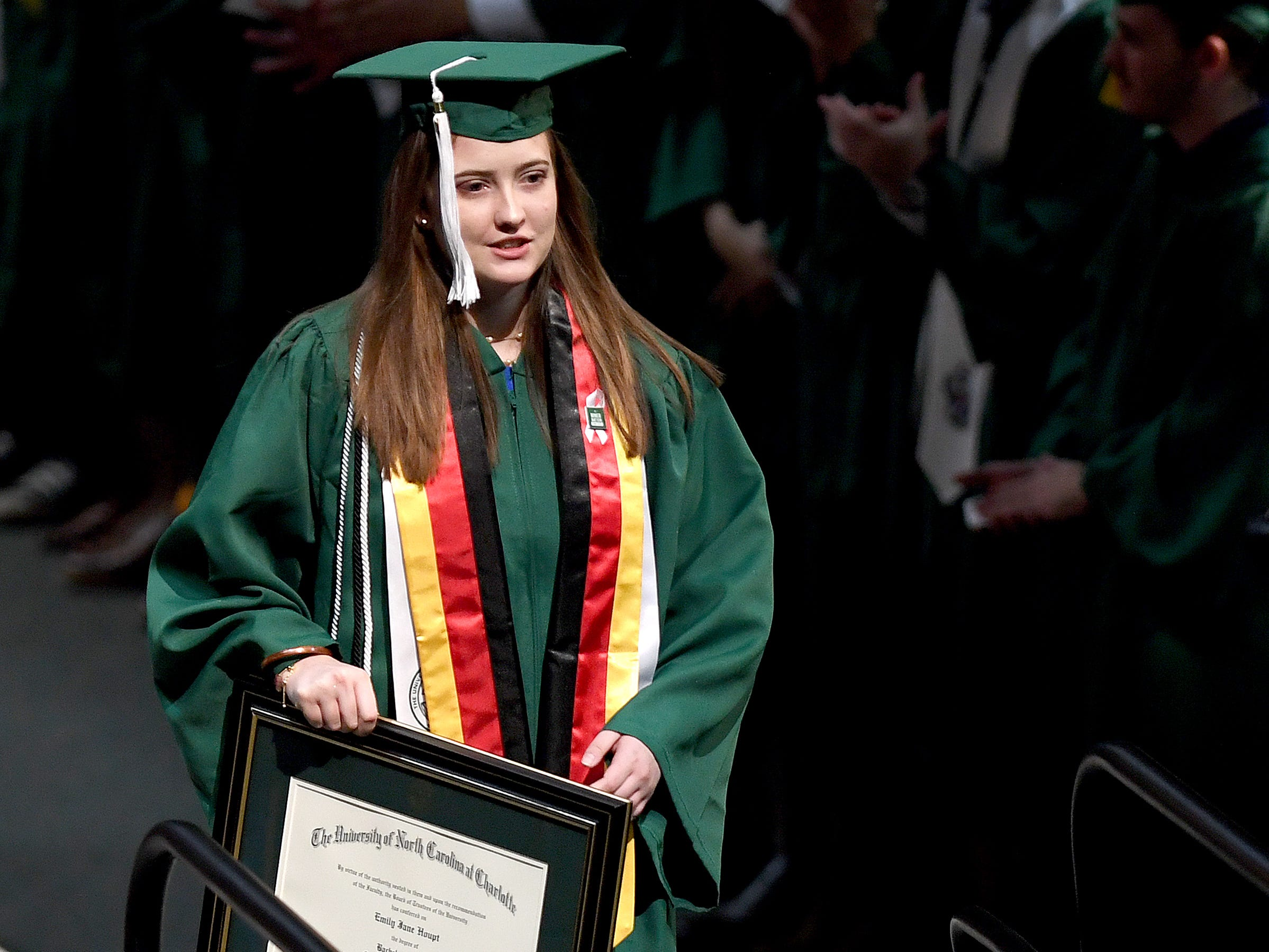 UNC Charlotte graduate Emily Houpt is honored as she receives her B.A in International Studies during the University's Commencement ceremony for the College of Liberal Arts and Sciences in Charlotte on May 11, 2019. Houpt was injured in the April 30 shooting at the university.
