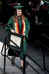 UNC Charlotte graduate Emily Houpt receives her B.A in International Studies during the university's commencement ceremony Saturday, May 11, 2019. Houpt was injured in the April 30 shooting at the university.