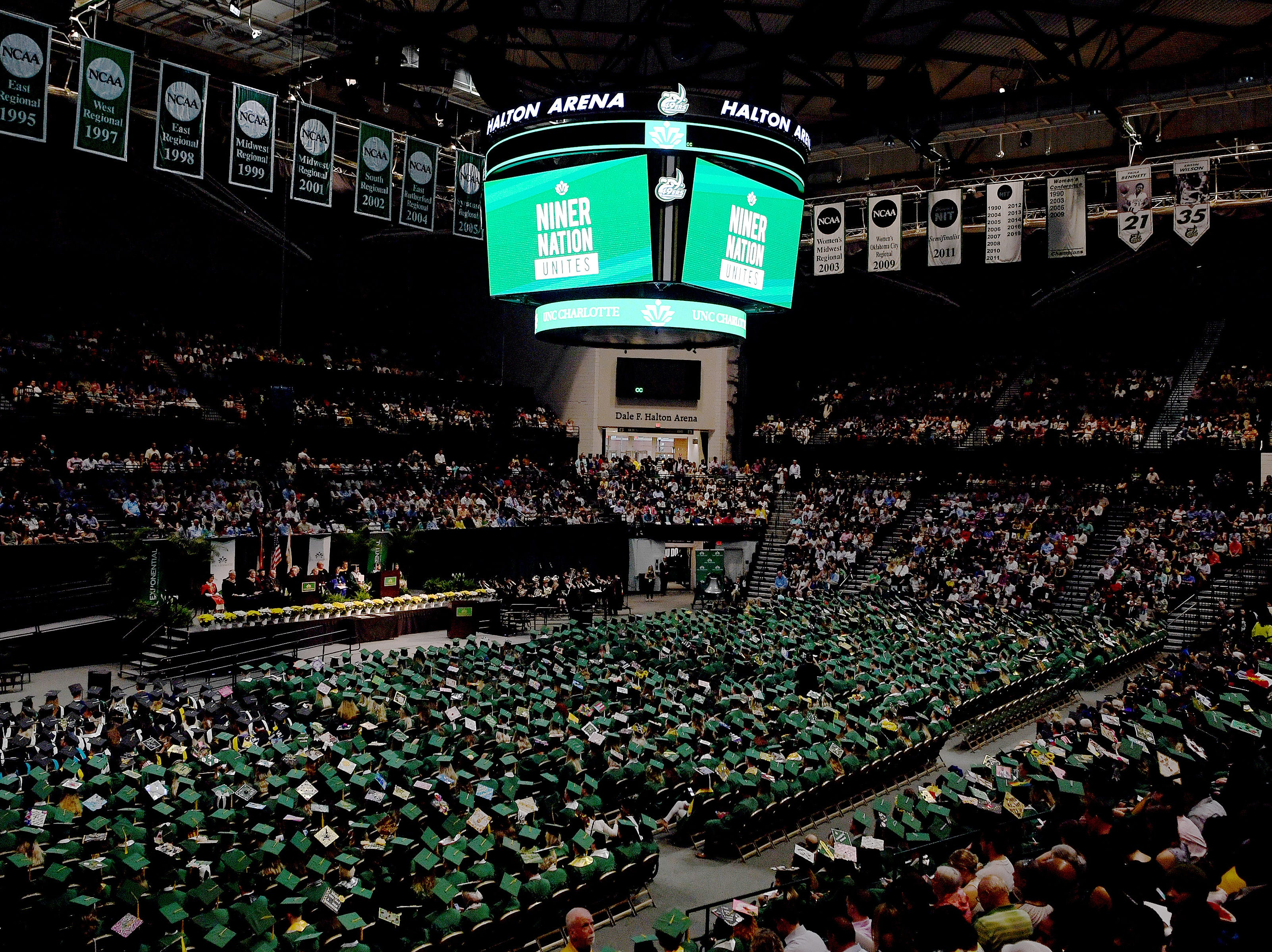 """The video screens in Halton Arena read """"Niner Nation Unites"""" as a moment of silence is observed to honor the victims of the April 30 shooting at UNC Charlotte during the University's Commencement ceremony for the College of Liberal Arts and Sciences in Charlotte on May 11, 2019."""