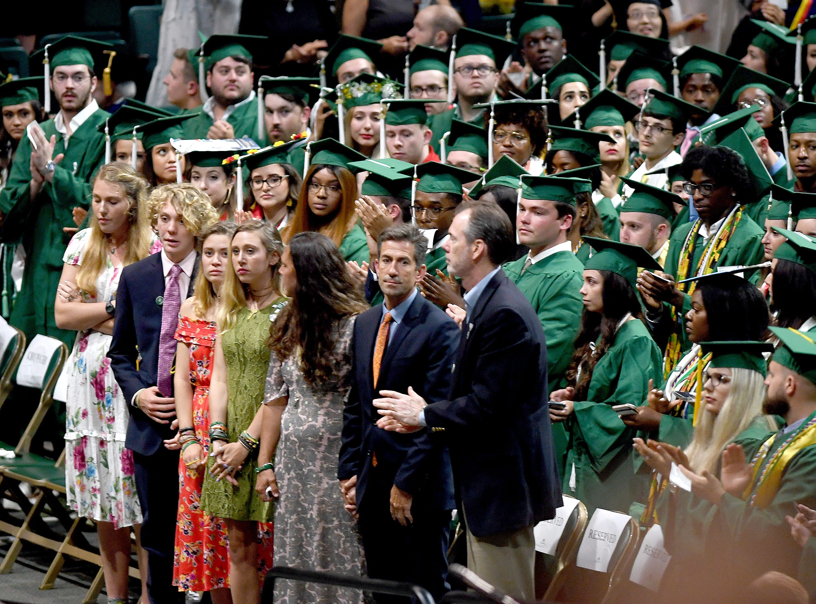 The family of UNC Charlotte shooting victim Riley Howell receives a standing ovation from graduates as he and his family are honored during the University's Commencement ceremony for the College of Liberal Arts and Sciences in Charlotte on May 11, 2019.
