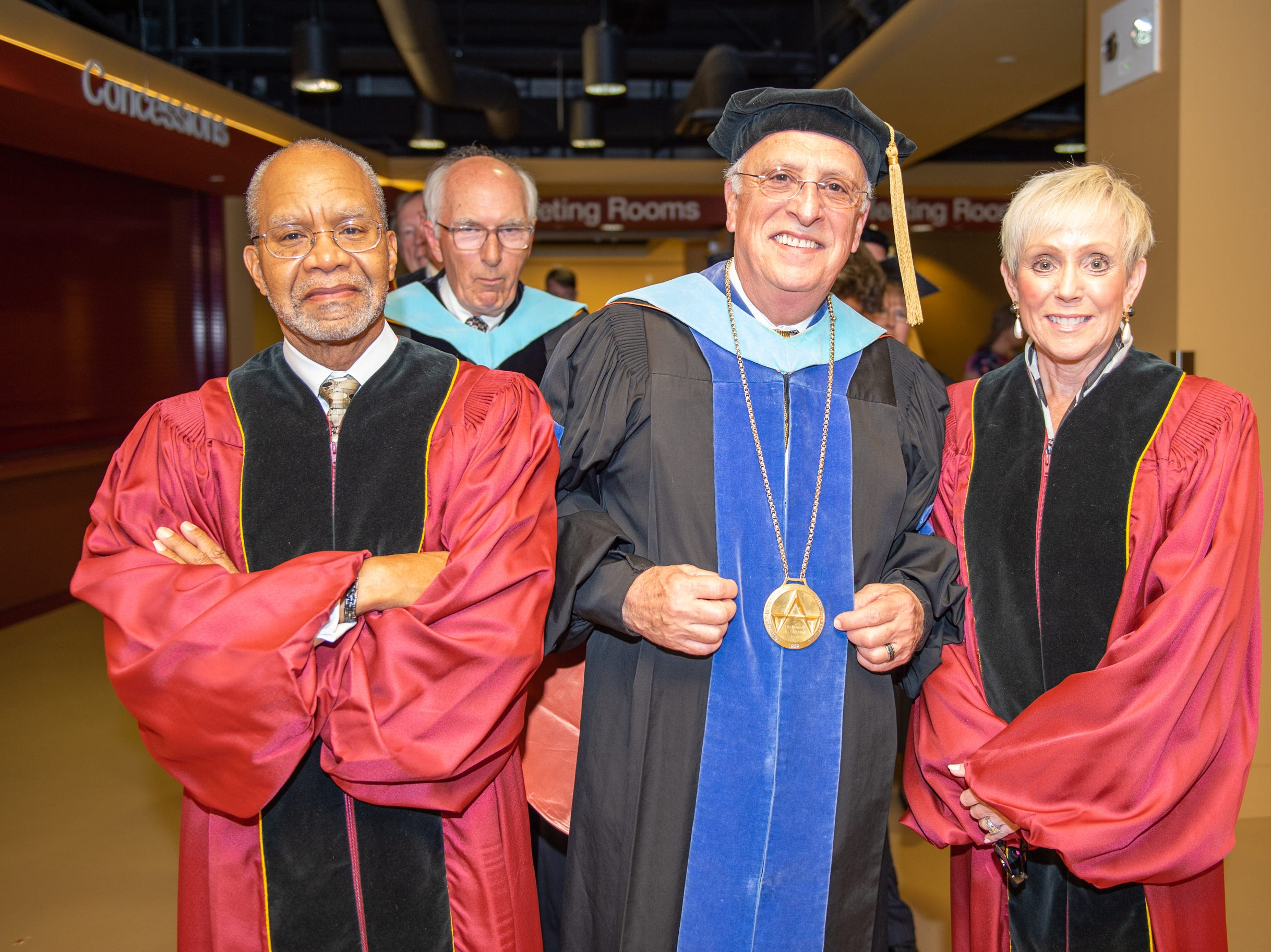 John Parham, Vice Chair, Dr. Dennis King, President, and Board Chair Mary Ann Rice lining up before the graduating ceremony on May 11, 2019