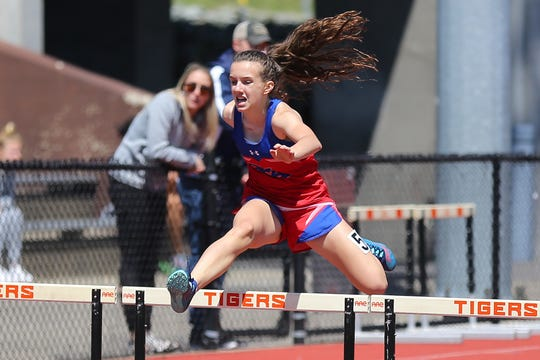 Alex Senko clears a hurdle on the way to her 400 meter heat win at the Parkhurst Invitational at U-E High School.