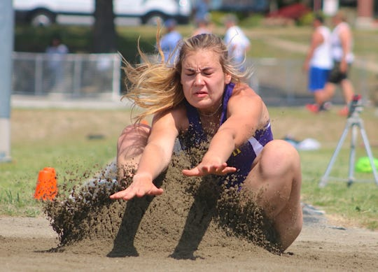 North Kitsap's Maddie Pruden hits the sand on her winning long jump at Saturday's Olympic League 2A track and field championship meet at North Kitsap.
