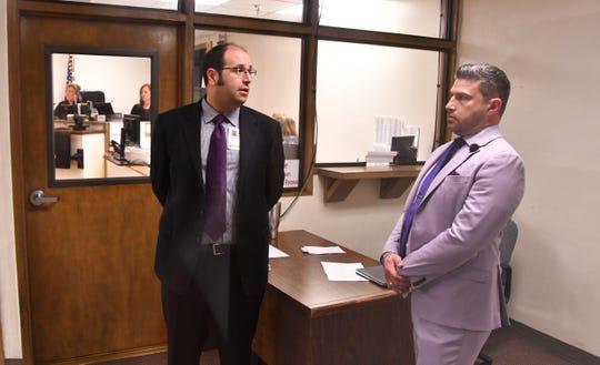 Attorney Bryan Lober taks with attorney Dan Martinez.  Judge Kelly Ingram denied bond to Dave Isnardi and Jose Aguiar Saturday morning.