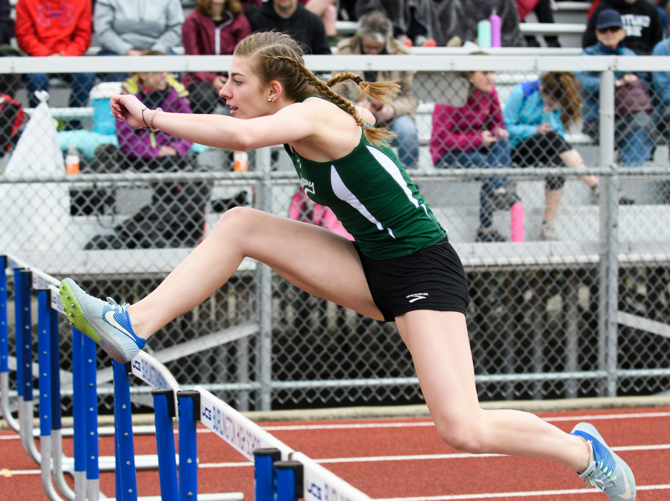 St. Johnsbury's Hannah Davis competes in the 100m hurdles during the Burlington Invitational high school track and field meet at Buck Hard Field on Saturday May 11, 2019 in Burlington, Vermont.