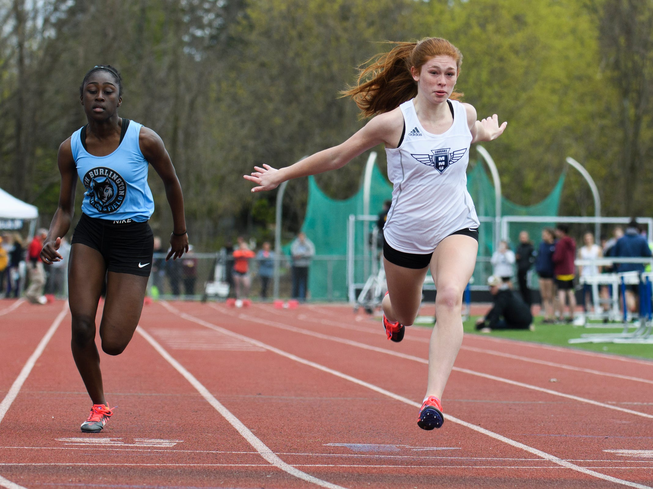 MMU's Jada Diamond crosses the finish line in first in the girls 100m dash during the Burlington Invitational high school track and field meet at Buck Hard Field on Saturday May 11, 2019 in Burlington, Vermont.