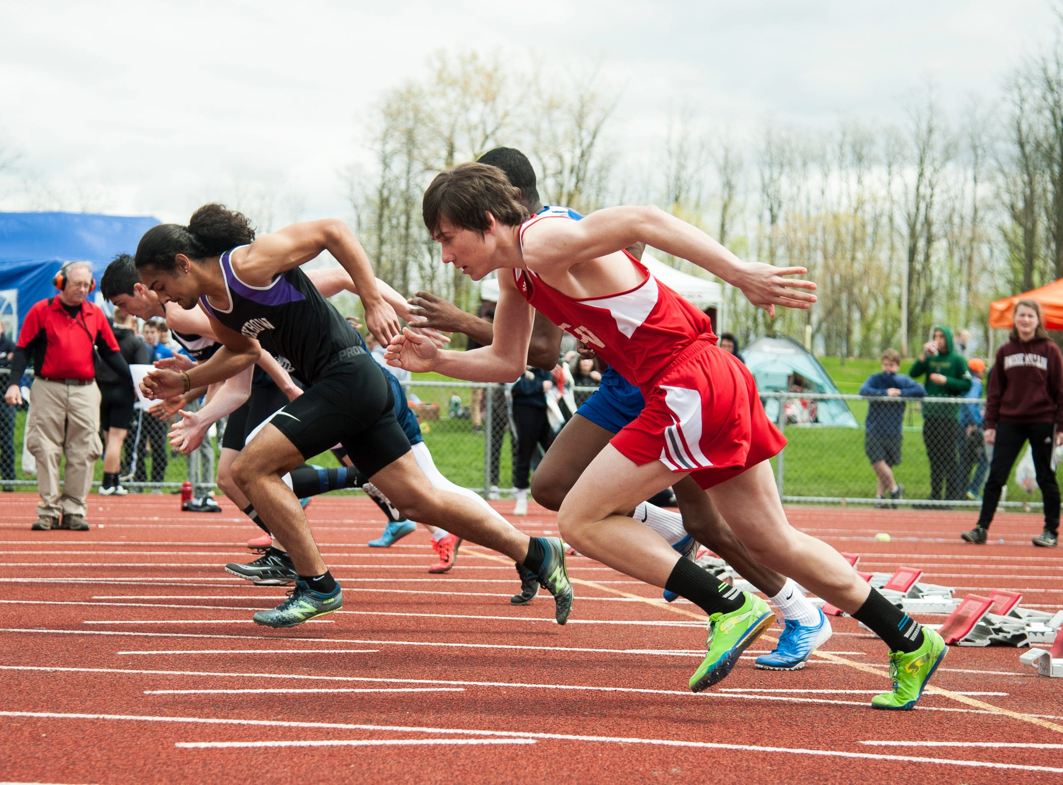 Boys take off from the starting block in the 100m prelims during the Burlington Invitational high school track and field meet at Buck Hard Field on Saturday May 11, 2019 in Burlington, Vermont.