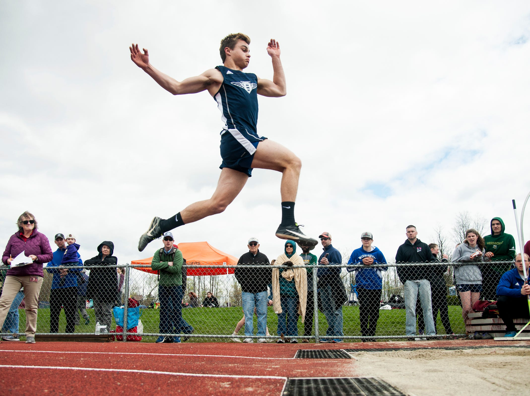 MMU's Will Hauf competes in the long jump during the Burlington Invitational high school track and field meet at Buck Hard Field on Saturday May 11, 2019 in Burlington, Vermont.