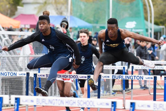 Burlington's Kai Schmidt-Bilowith and Essex's Jamaal Hankey battle for first place as they race in the 100m hurdles during the Burlington Invitational high school track and field meet at Buck Hard Field on Saturday May 11, 2019 in Burlington, Vermont.