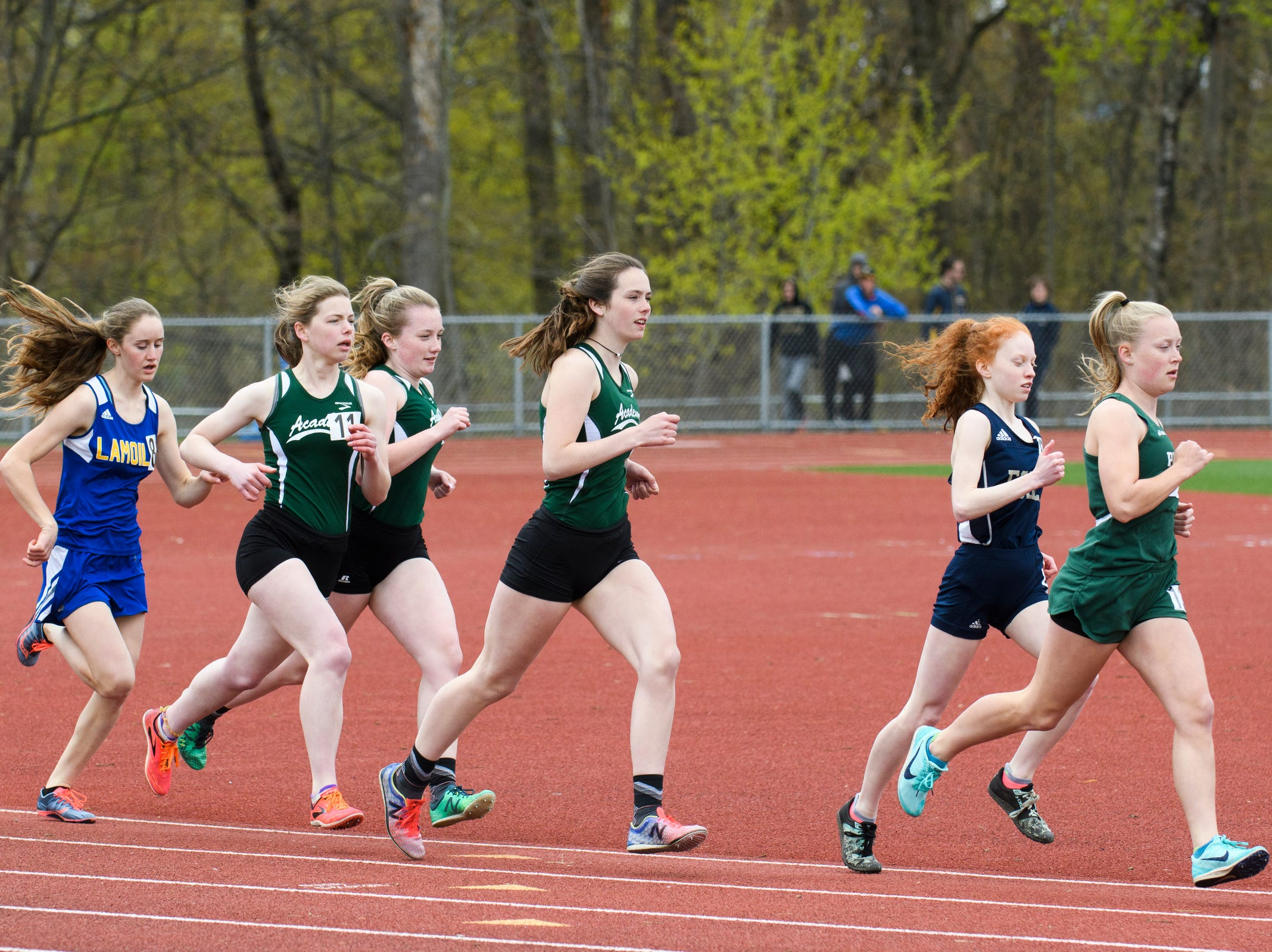 Girls compete in the 1500m during the Burlington Invitational high school track and field meet at Buck Hard Field on Saturday May 11, 2019 in Burlington, Vermont.