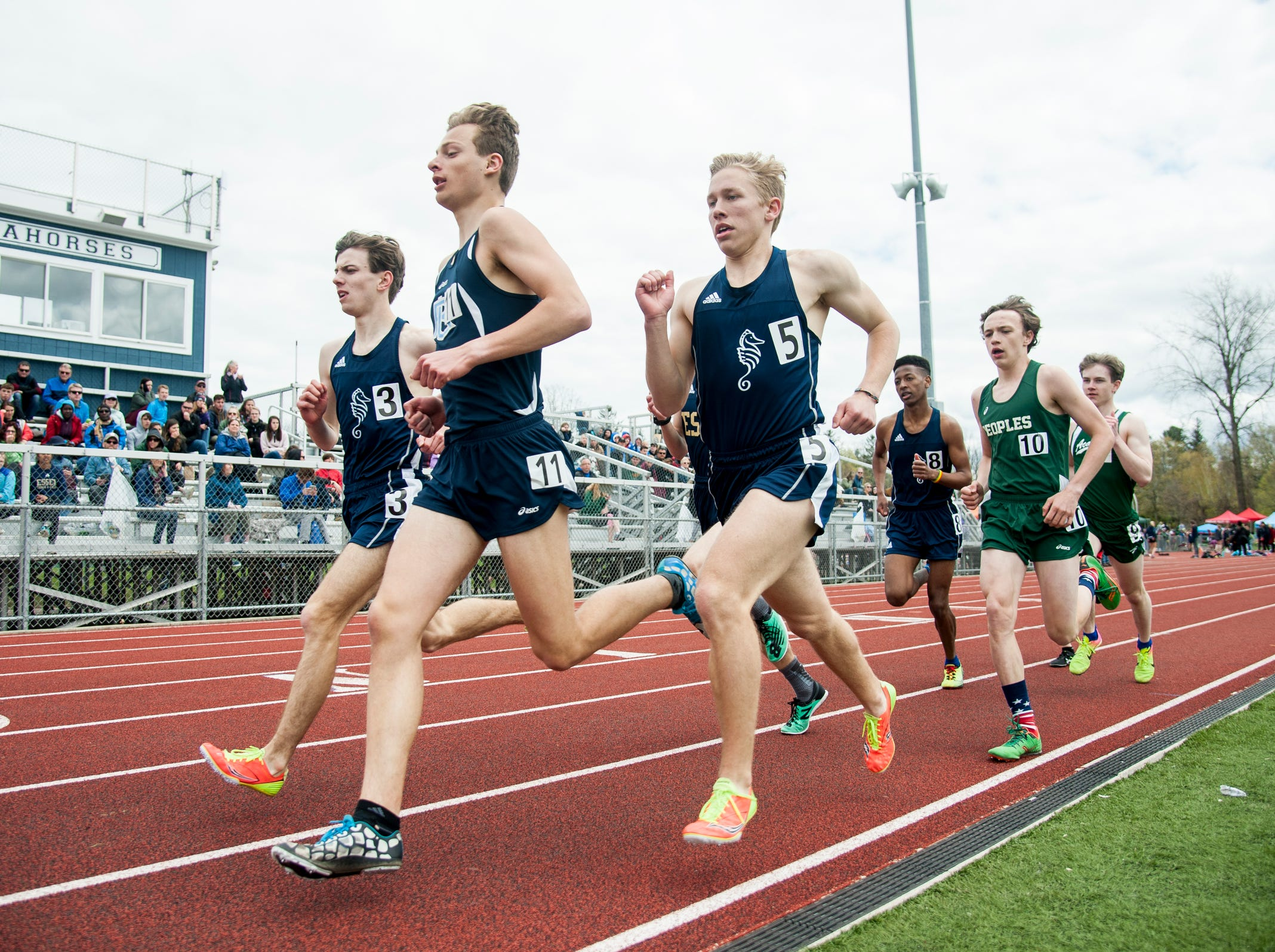 Boys compete in the 1500m race during the Burlington Invitational high school track and field meet at Buck Hard Field on Saturday May 11, 2019 in Burlington, Vermont.