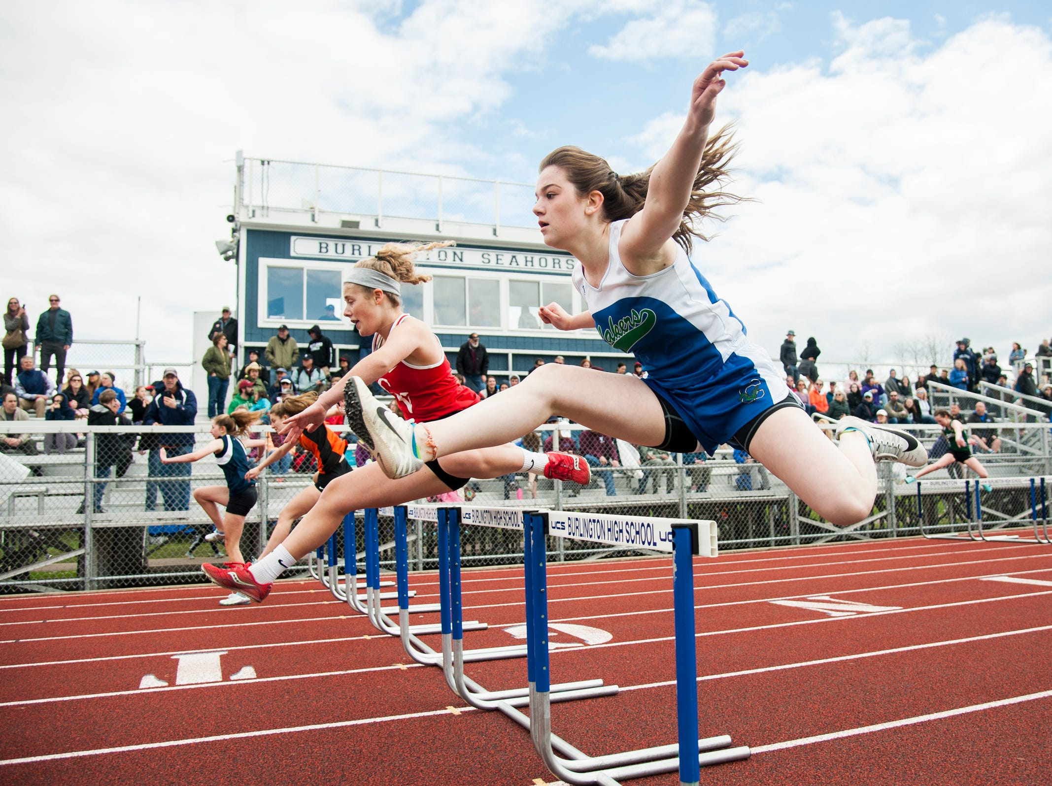 Colchester's Bailee Viau runs in the 100m hurdles event during the Burlington Invitational high school track and field meet at Buck Hard Field on Saturday May 11, 2019 in Burlington, Vermont.