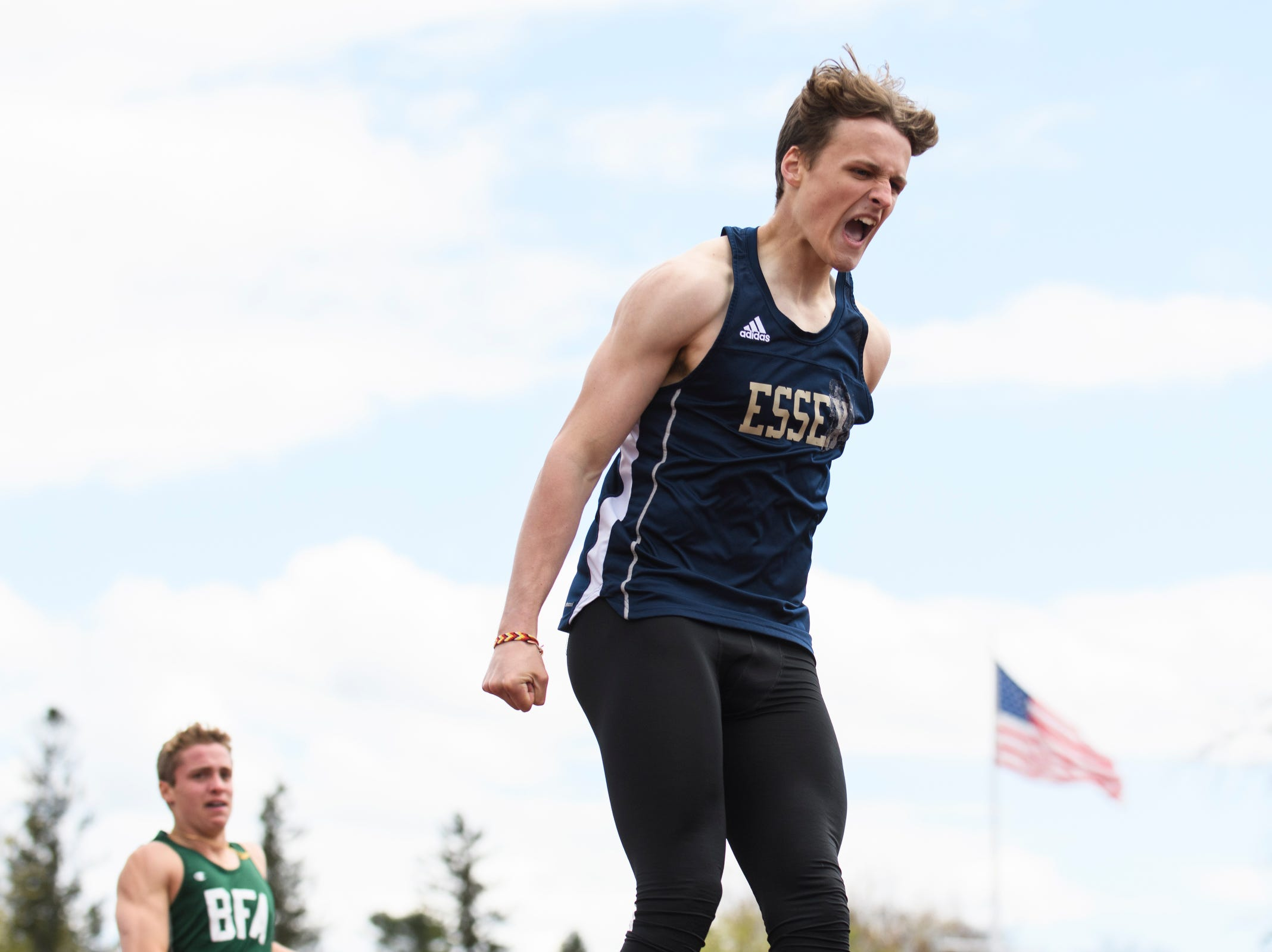 Essex's James Boldosser celebrates as he crosses the finish line in first place in the 400m dash during the Burlington Invitational high school track and field meet at Buck Hard Field on Saturday May 11, 2019 in Burlington, Vermont.