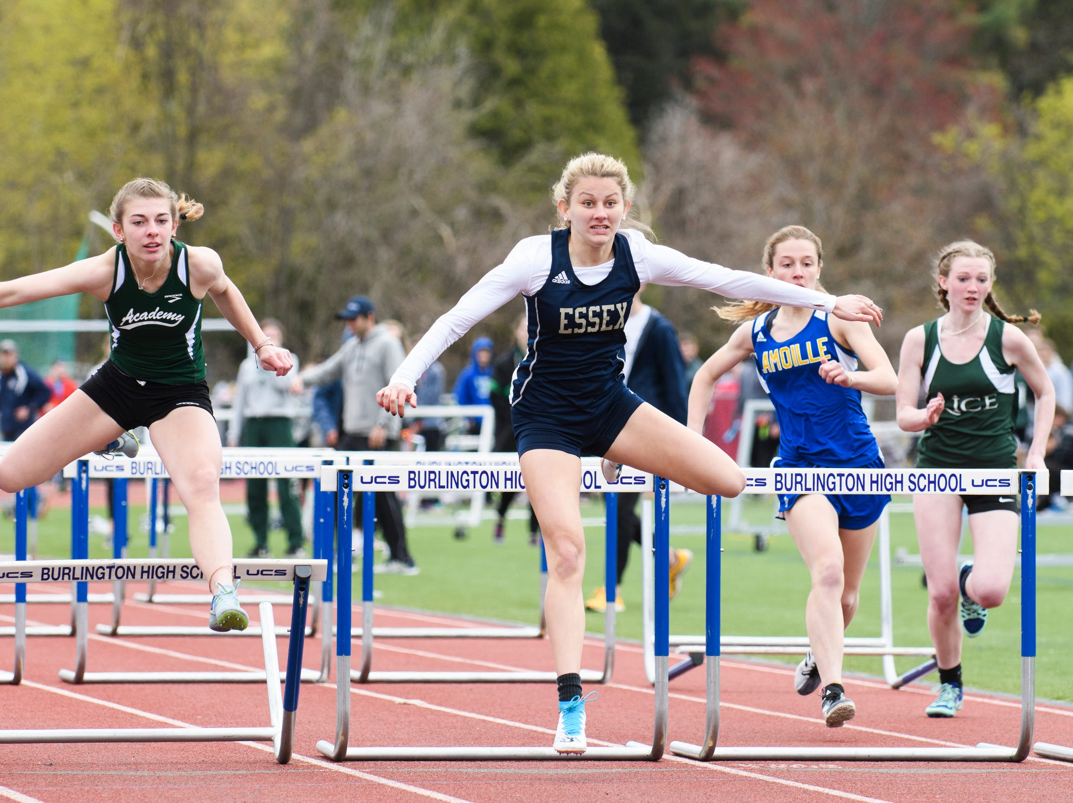Essex's Nejla Hadzic leads the pack of runners in the 100m hurdles during the Burlington Invitational high school track and field meet at Buck Hard Field on Saturday May 11, 2019 in Burlington, Vermont.