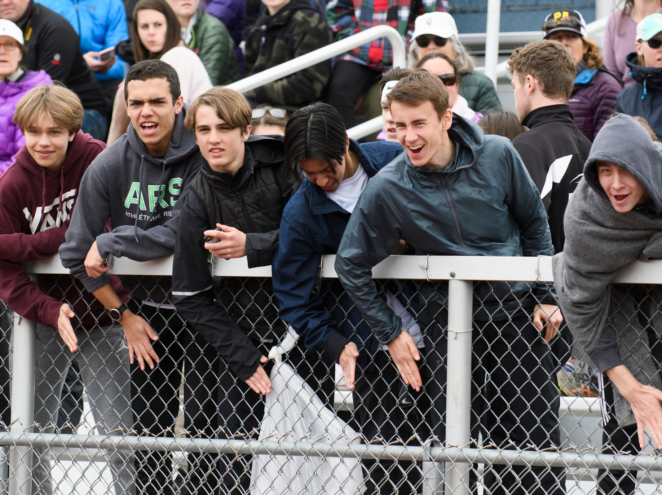 Fans cheer for the boys 1500m race during the Burlington Invitational high school track and field meet at Buck Hard Field on Saturday May 11, 2019 in Burlington, Vermont.