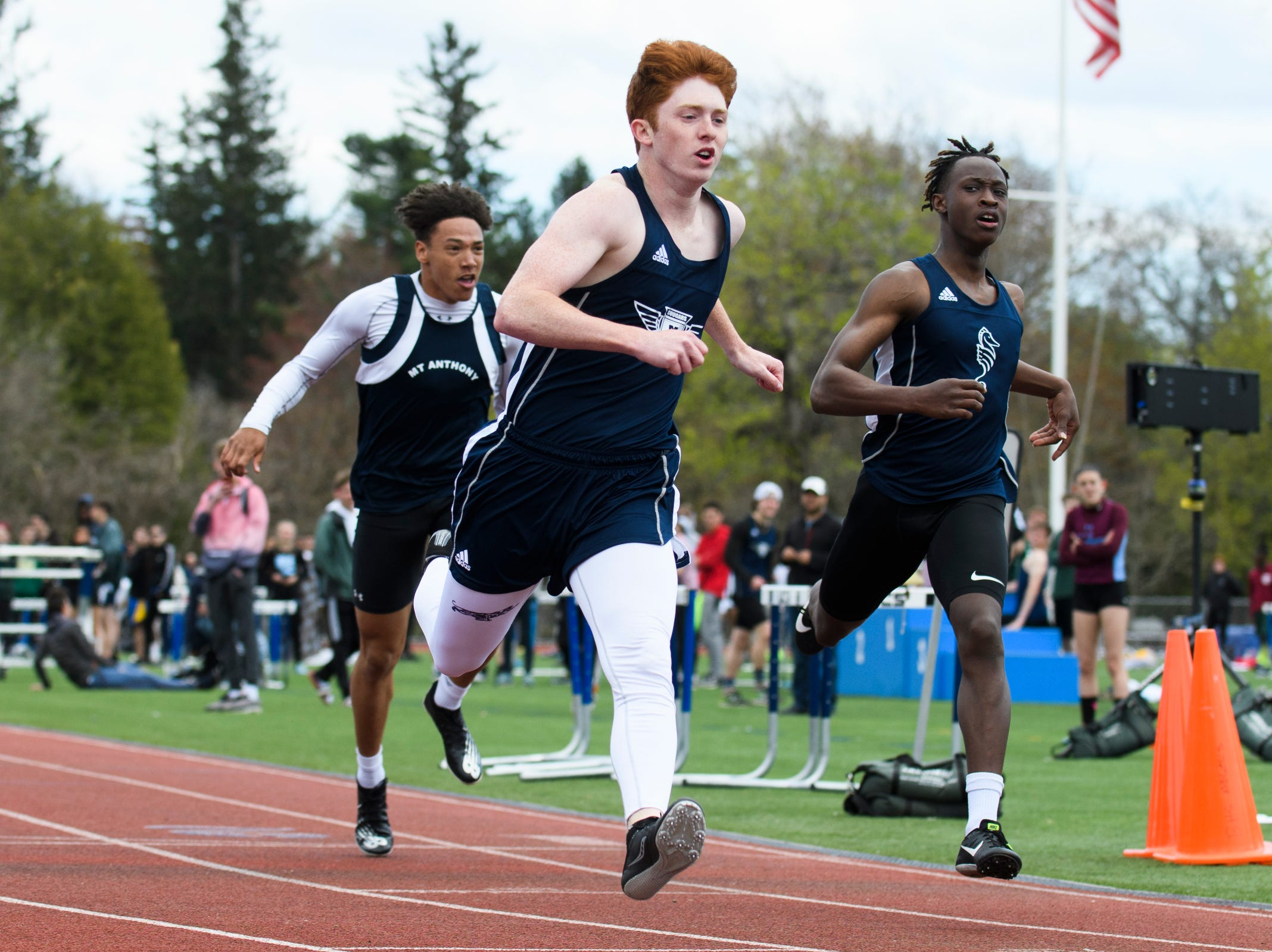 MMU's Silas Diamond crosses the finish line in first in the 100m dash during the Burlington Invitational high school track and field meet at Buck Hard Field on Saturday May 11, 2019 in Burlington, Vermont.