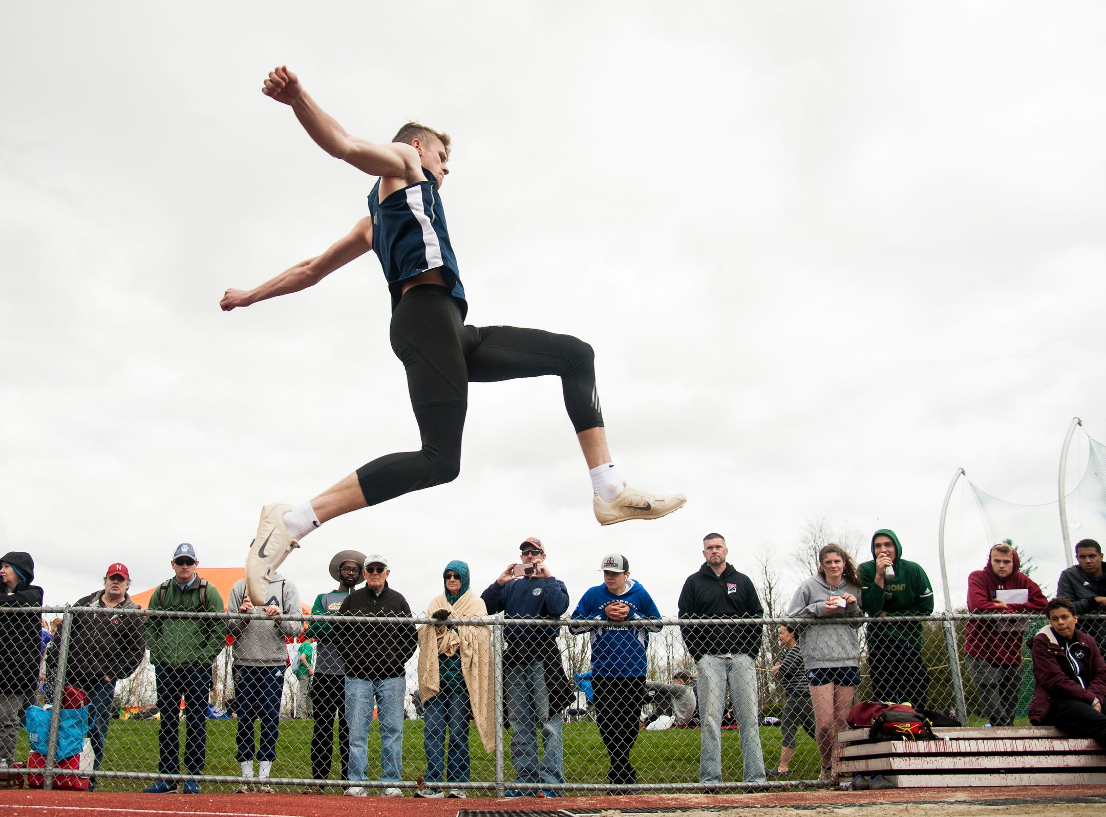 Essex's Ryan Guerino competes in the long jump during the Burlington Invitational high school track and field meet at Buck Hard Field on Saturday May 11, 2019 in Burlington, Vermont.