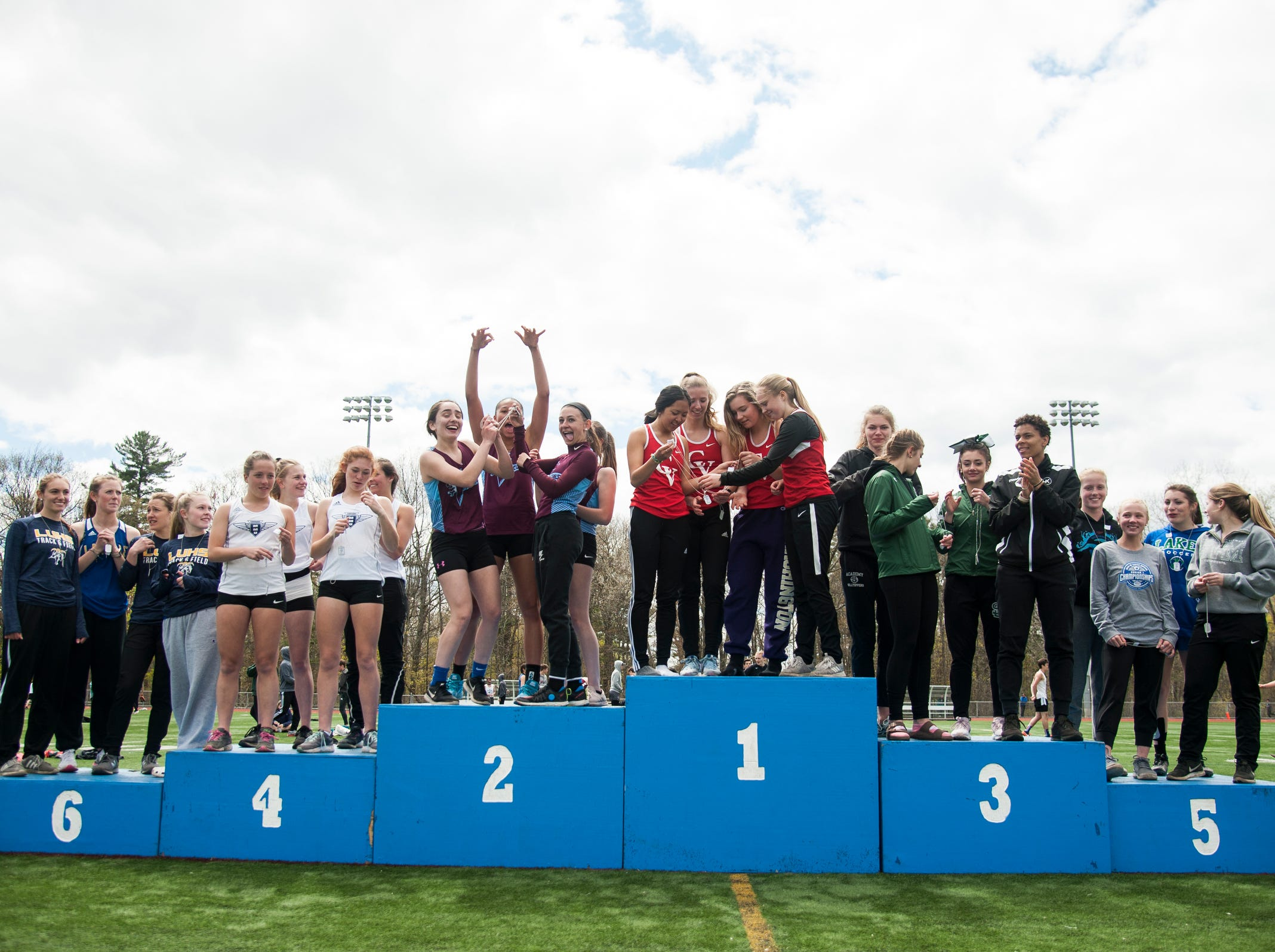 The relay runners receiver their awards during the Burlington Invitational high school track and field meet at Buck Hard Field on Saturday May 11, 2019 in Burlington, Vermont.