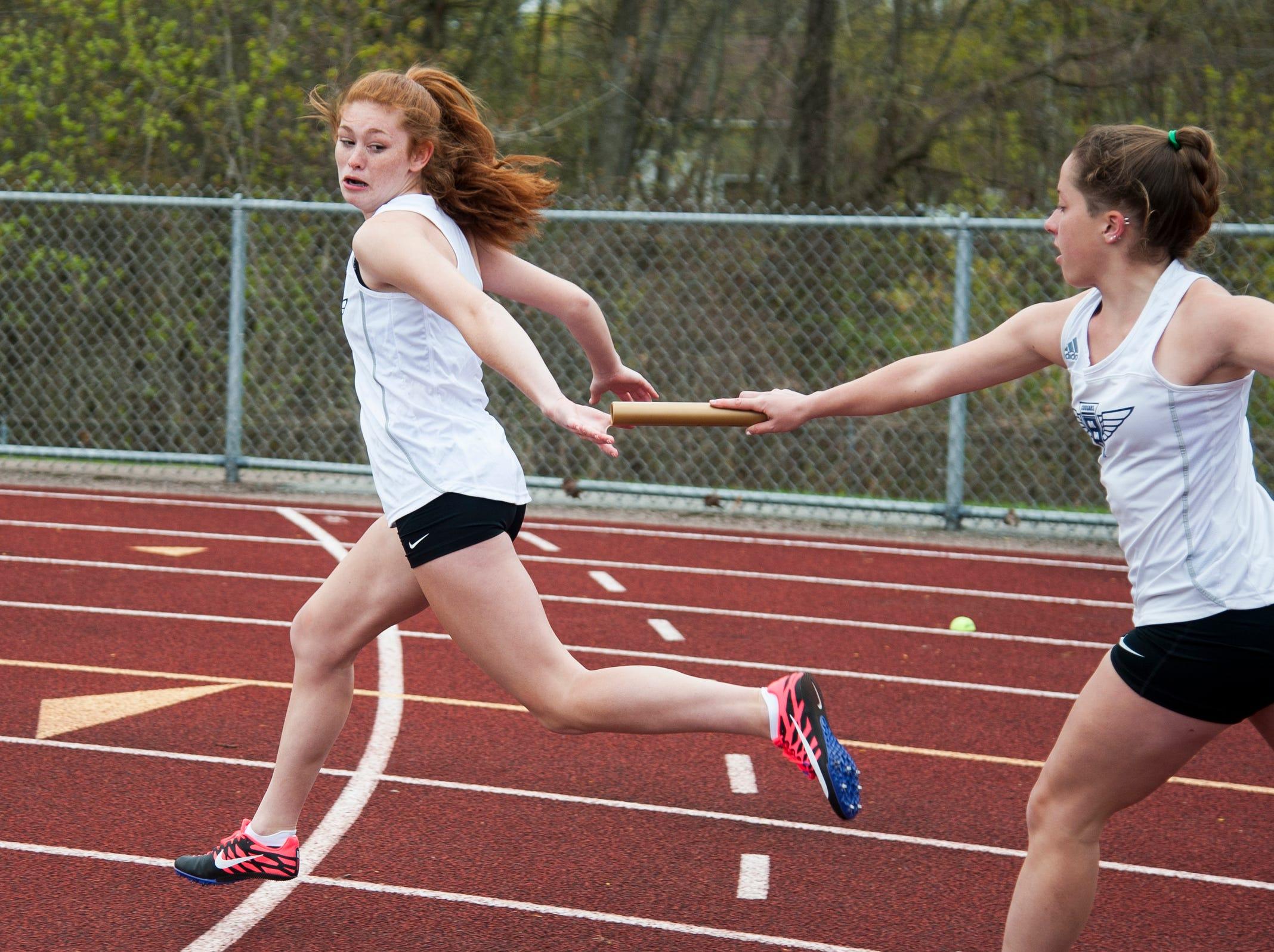 MMU's Ava Esmay hands off the baton to Jada Diamond in the girl 4x100m race during the Burlington Invitational high school track and field meet at Buck Hard Field on Saturday May 11, 2019 in Burlington, Vermont.