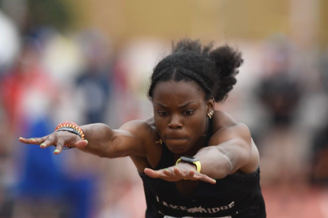 Mansfield Lake Ridge's Jasmine Moore set a national high school triple jump record on Saturday at the UIL State Track & Field Meet.