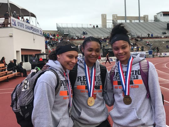 Refugio long jumpers Jai'lin King, Alexa Valenzuela and Tracelyn Ross pose after sweeping the medal stand in the Class 2A girls long jump. Only the Panhandle High School boys have ever accomplished the feat, doing it in the shot put in 2014.