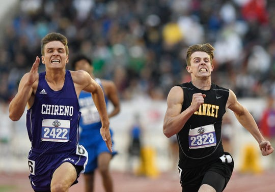 Blanket junior Logan Wheeler, right, runs the 100 next to Chireno's Hunter Metteauer.