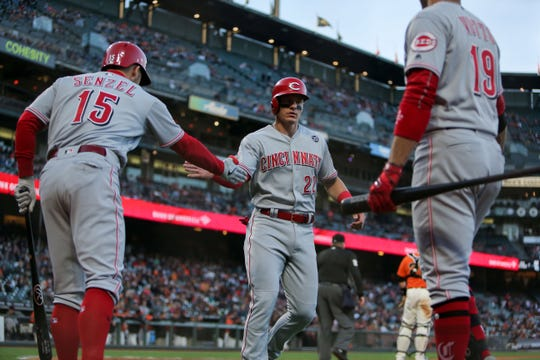 May 10, 2019; San Francisco, CA, USA; Cincinnati Reds left fielder Derek Dietrich (22) celebrates with third baseman Nick Senzel (15) after scoring a run against the San Francisco Giants during the second inning at Oracle Park. Mandatory Credit: Sergio Estrada-USA TODAY Sports